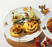 Polenta faces and cucumber boats on child's plate