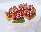 Strawberry gateau with lime cream, pieces cut