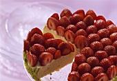 Strawberry gateau with lime cream, a piece cut
