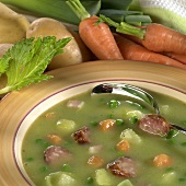 Pea soup with potatoes and sausage slices