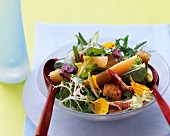 Mixed salad leaves with flowers, melon pieces & croutons