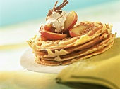 Several apples waffles with apple wedges and cinnamon cream