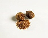 Whole and grated nutmeg with nutmeg powder
