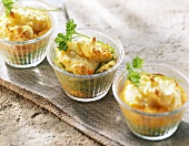 Baked potato, carrot and pea puree in dish