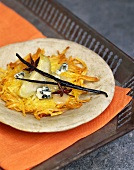 Rosti with cheese, pear, vanilla pod and star anise
