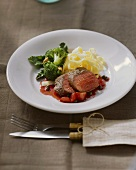 Venison medallions with strawberry and pepper sauce