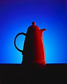 Red Thermos jug against blue background