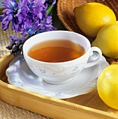 A cup of tea with lemon