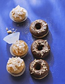 Coconut muffins and chocolate donuts with candied ginger