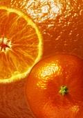 Mandarin halves, background: mandarin peel