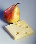 A piece of Emmental cheese and a pear