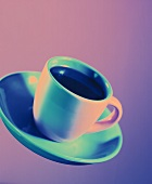 A cup of espresso in violet light