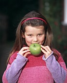 Girl with a Granny Smith apple