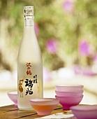 A bottle of sake and sake bowls