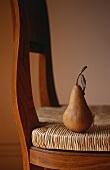 A pear on a chair
