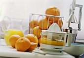 Still life with juicer, oranges and orange juice