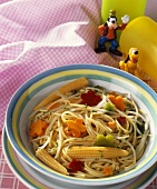 Spaghetti with baby corncobs and vegetables