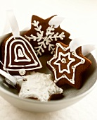 Decorated chocolate biscuits as tree ornaments