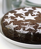 Chocolate cake decorated with icing sugar stars