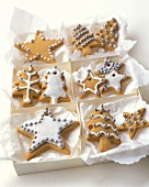 Glazed biscuits with silver balls as tree ornaments