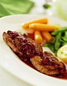 Pork escalope with beetroot sauce and vegetables