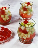 Punch with cocktail cherries in glasses
