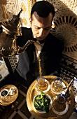 Man pouring peppermint tea (L'Atlas I'Saidi, Paris)