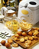 Still life with deep fryer and various fried vegetables