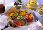 Beef steak and four different butter mixtures