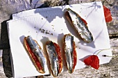 Crostini with sardines on white cloth