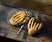 French olive bread on wooden board with olive branches