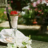 Yoghurt mousse with raspberries and redcurrants in glass
