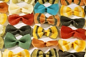 Colourful farfalle (filling the picture)