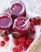 Three jars of raspberry jam