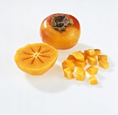 Sharon fruit: whole, halved and in pieces
