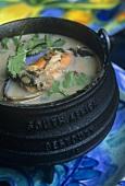 Mussel stew with parsley (Potjiekos)