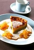 A piece of Crème Catalan tart with orange sauce