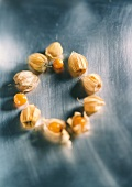 Cape gooseberries with & without husk, laid out in a circle