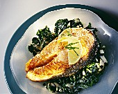 Salmon cutlet on spinach