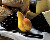 Still life with cheese, fruit and bread