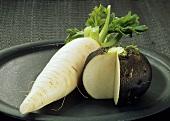 White radish and black radish, pieces cut off