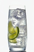 Glass of mineral water with ice cubes and lemon slices