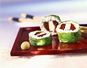 Sushi rolls with mozzarella and basil leaf