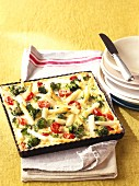 Asparagus quiche with broccoli & cherry tomatoes on baking tray