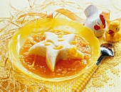 Honey millet pudding with orange and apricot sauce