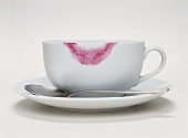 Coffee cup with lipstick print