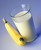 A glass of banana-flavoured milk and a banana