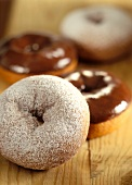 Doughnuts with icing sugar and with chocolate icing