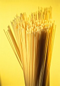 Spaghetti against yellow background
