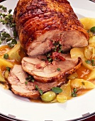 Roast pork roll with bacon and herb stuffing